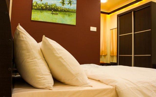 Отель Beverly Park Inn Мале комната для гостей