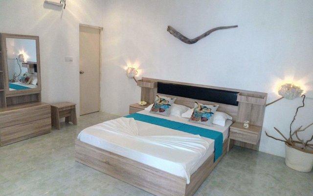 Отель Maison Tiare' Maldives Thulusdhoo Остров Гасфинолу комната для гостей