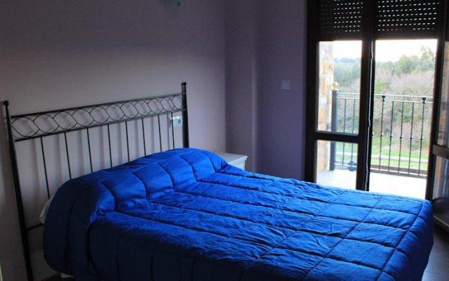 Отель Apartamentos La Fragata Испания, Арнуэро - отзывы, цены и фото номеров - забронировать отель Apartamentos La Fragata онлайн комната для гостей