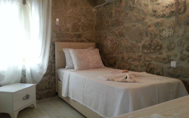 Отель Köşem Konukevi Чешме комната для гостей