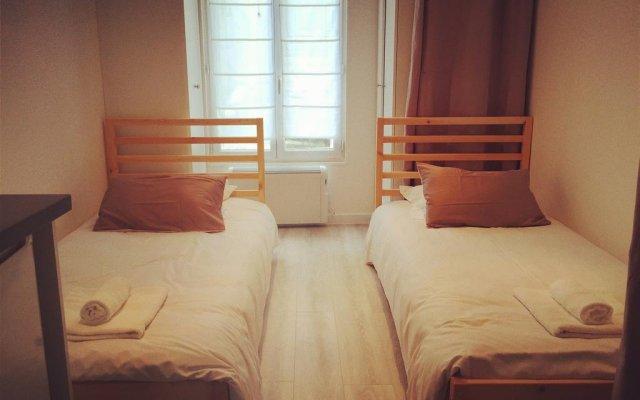 Апартаменты Studio Paris Apartment - Jobs Париж комната для гостей