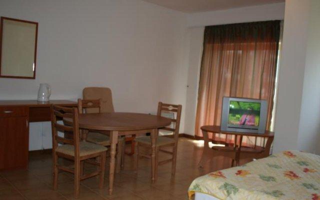 Апартаменты Eagle Lodge Apartments Банско комната для гостей