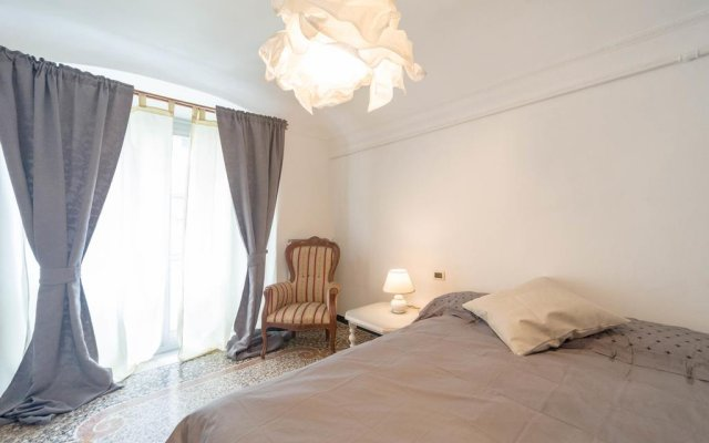 Отель Appartamento Piazza delle Oche Генуя комната для гостей