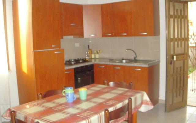 Отель Appartamento La Caletta Синискола в номере