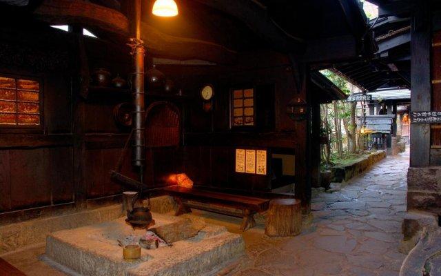 Отель Kurokawa Onsen Yama No Yado Shinmeikan Минамиогуни интерьер отеля