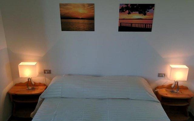 Отель Villetta Al Torchio Манерба-дель-Гарда комната для гостей