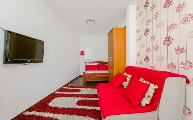 Апартаменты Apartments Feniks комната для гостей