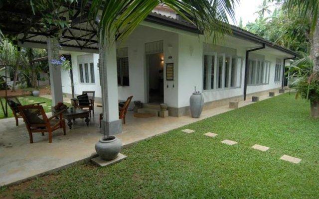 Отель Lilly Village