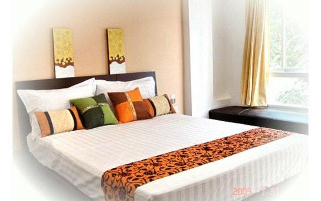 Апартаменты The Nara-ram 3 Suite Boutique Service Apartment Бангкок комната для гостей
