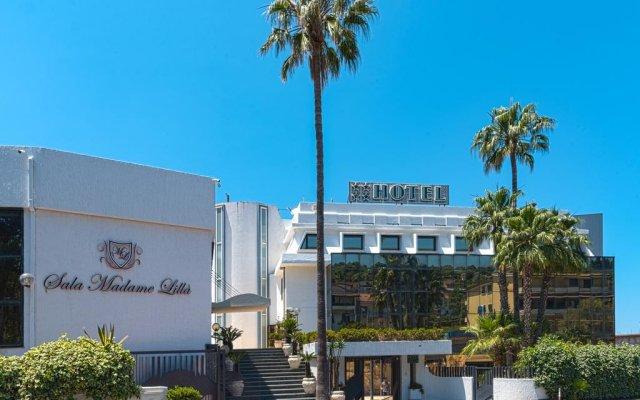 Hotel Residence Arcobaleno Пальми вид на фасад