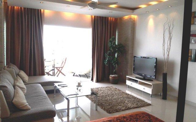 Апартаменты Studio Veiwtalay 7 Паттайя комната для гостей