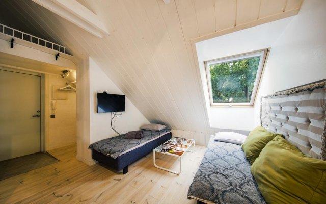 Апартаменты Apple 9 Studio комната для гостей