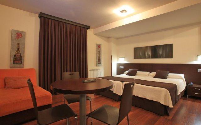 Отель Apartamentos Rurales L'Arquera комната для гостей