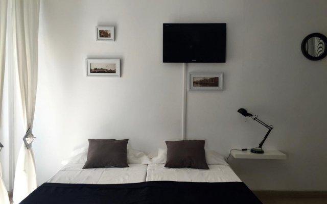 Отель Madrid Center Suites комната для гостей