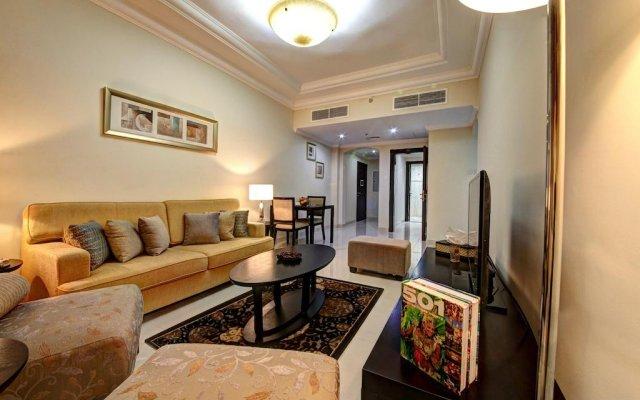 Adamo Hotel Apartments комната для гостей