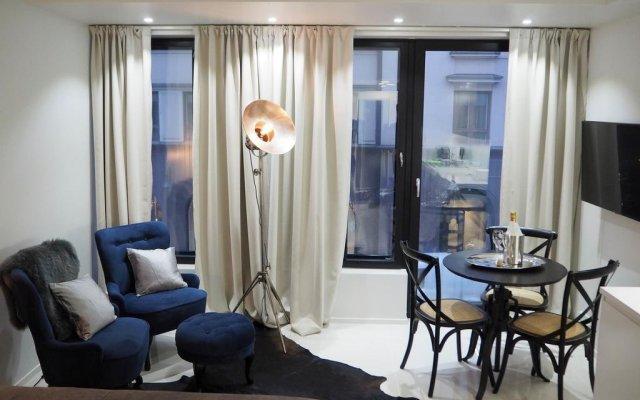 Апартаменты Helsinki Homes Apartments комната для гостей