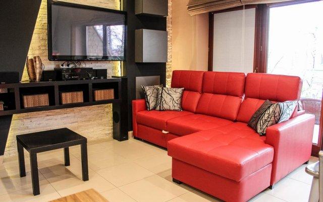 Апартаменты Szymoszkowa Residence Luxury Apartments Косцелиско комната для гостей