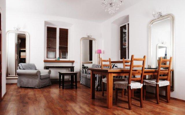 Апартаменты Ambiance Apartments Варшава комната для гостей