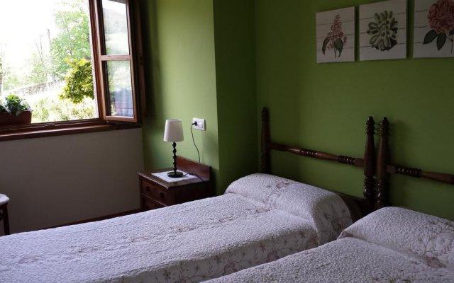 Отель Apartamentos Rurales El Picoretu комната для гостей