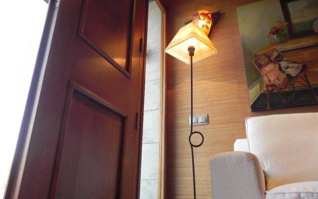 Отель Apartamentos Cueto Mazuga I комната для гостей