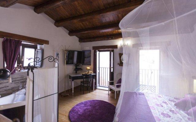 Отель Ortigia Deluxe S.A.L. Сиракуза комната для гостей