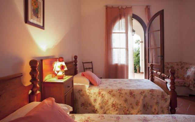 Отель Agriturismo Tra gli Ulivi Кастаньето-Кардуччи комната для гостей