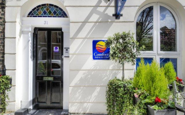 Отель Comfort Inn & Suites Kings Cross Лондон банкомат