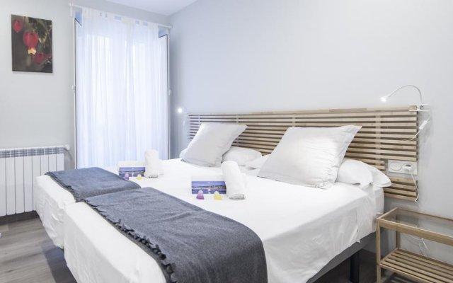 Отель Concha Beach Boutiques - SSHousing Испания, Сан-Себастьян - отзывы, цены и фото номеров - забронировать отель Concha Beach Boutiques - SSHousing онлайн комната для гостей