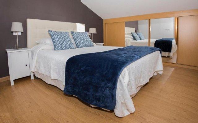 Апартаменты Apartments Llanes & Golf комната для гостей