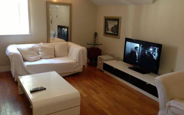 Апартаменты London Apartment комната для гостей
