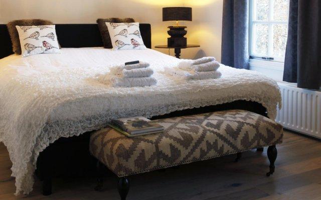 Отель Christie's Huiskamer комната для гостей