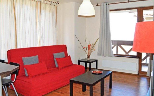 Апартаменты Neon Gondola Lift Apartments Банско комната для гостей