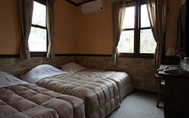 Отель Pension Poteri Ито комната для гостей