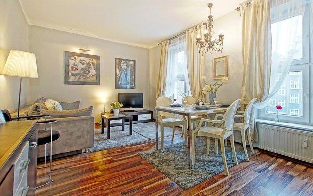 Апартаменты Apartment Kameralny VIII комната для гостей