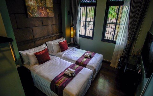 Отель Tha Tian Store Бангкок комната для гостей