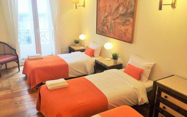 Отель Flores 105 Лиссабон комната для гостей