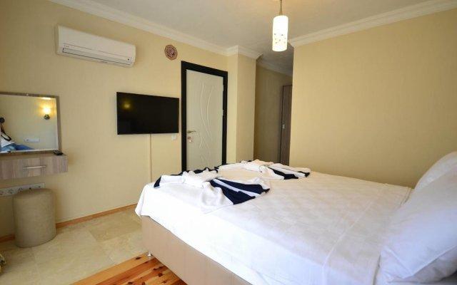 Villa Kelebek Oz Турция, Патара - отзывы, цены и фото номеров - забронировать отель Villa Kelebek Oz онлайн комната для гостей