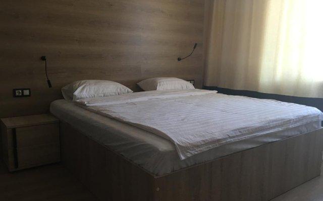 Гостиница Postoyaliy Dvor Inn в Уссурийске отзывы, цены и фото номеров - забронировать гостиницу Postoyaliy Dvor Inn онлайн Уссурийск комната для гостей
