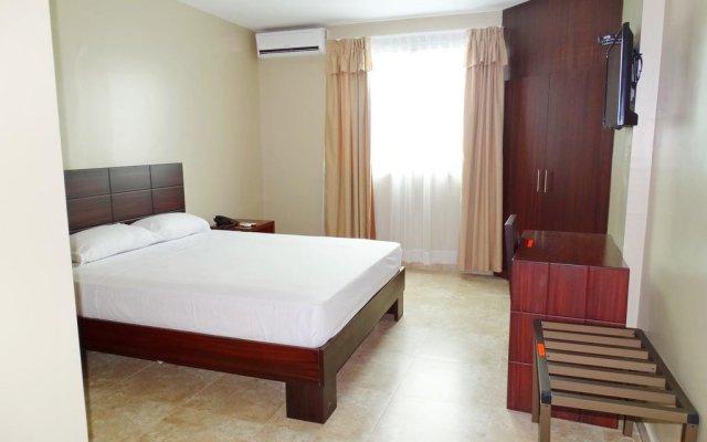 Hotel Marvento Suites комната для гостей