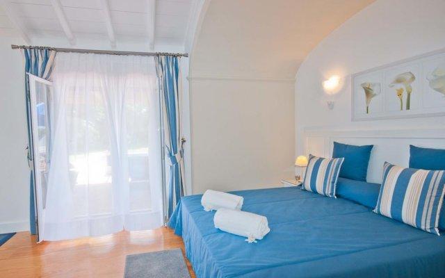 Отель Akivillas Olhos de Agua IV Португалия, Албуфейра - отзывы, цены и фото номеров - забронировать отель Akivillas Olhos de Agua IV онлайн комната для гостей