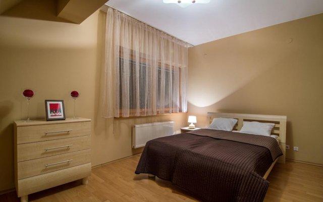 Отель Udanypobyt Apartament Orkana Park Centrum Закопане комната для гостей