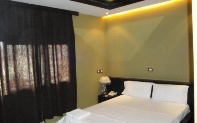 Epidami Hotel комната для гостей