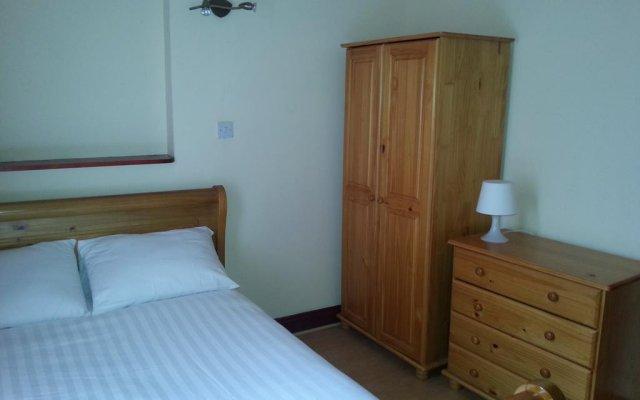 Апартаменты Kensington and Chelsea Apartment комната для гостей