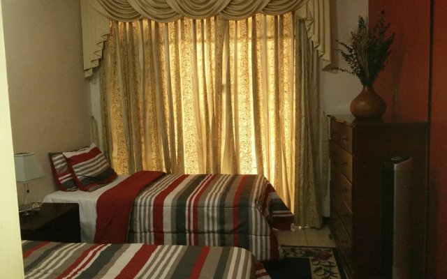 Отель Sweet Kensville комната для гостей