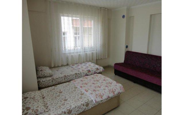 Отель Caner Pansiyon комната для гостей