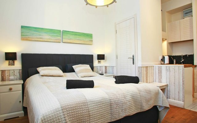 Апартаменты Monte Cassino Art Studio Сопот комната для гостей