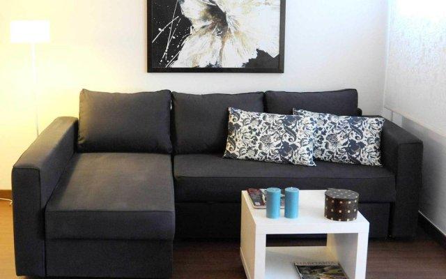 Апартаменты Your Home In Barcelona Apartments Барселона комната для гостей