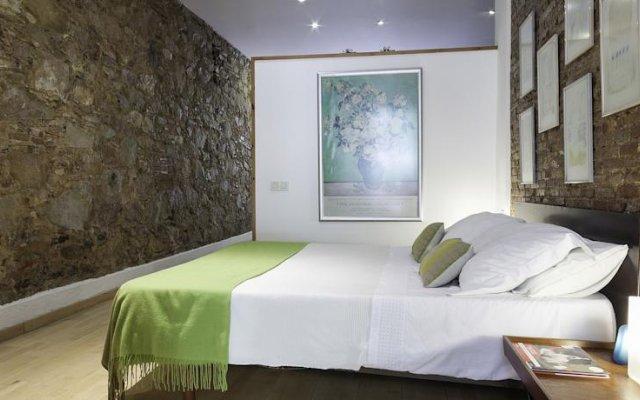 Апартаменты Home Around Gracia Apartments Барселона комната для гостей