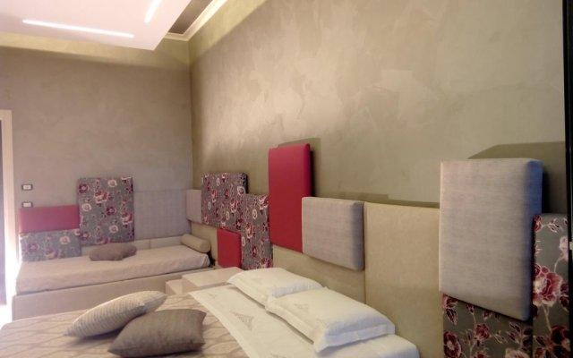 Отель B&B Coccolhouse Suite Лечче комната для гостей
