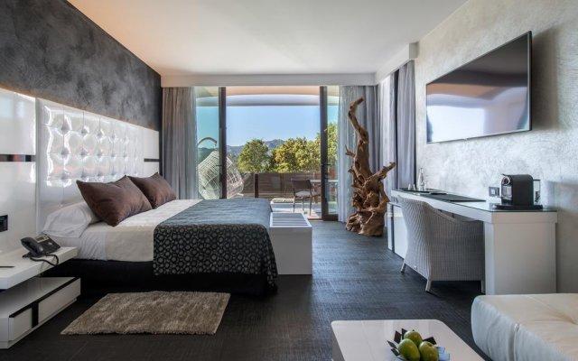 Отель Mas Tapiolas Suites Natura комната для гостей